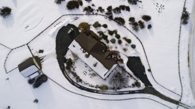Overhead of a home in the snow below Silver Mountain