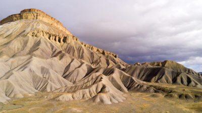 Mt Garfield's eastern ridge rises up to meet the falling sky.