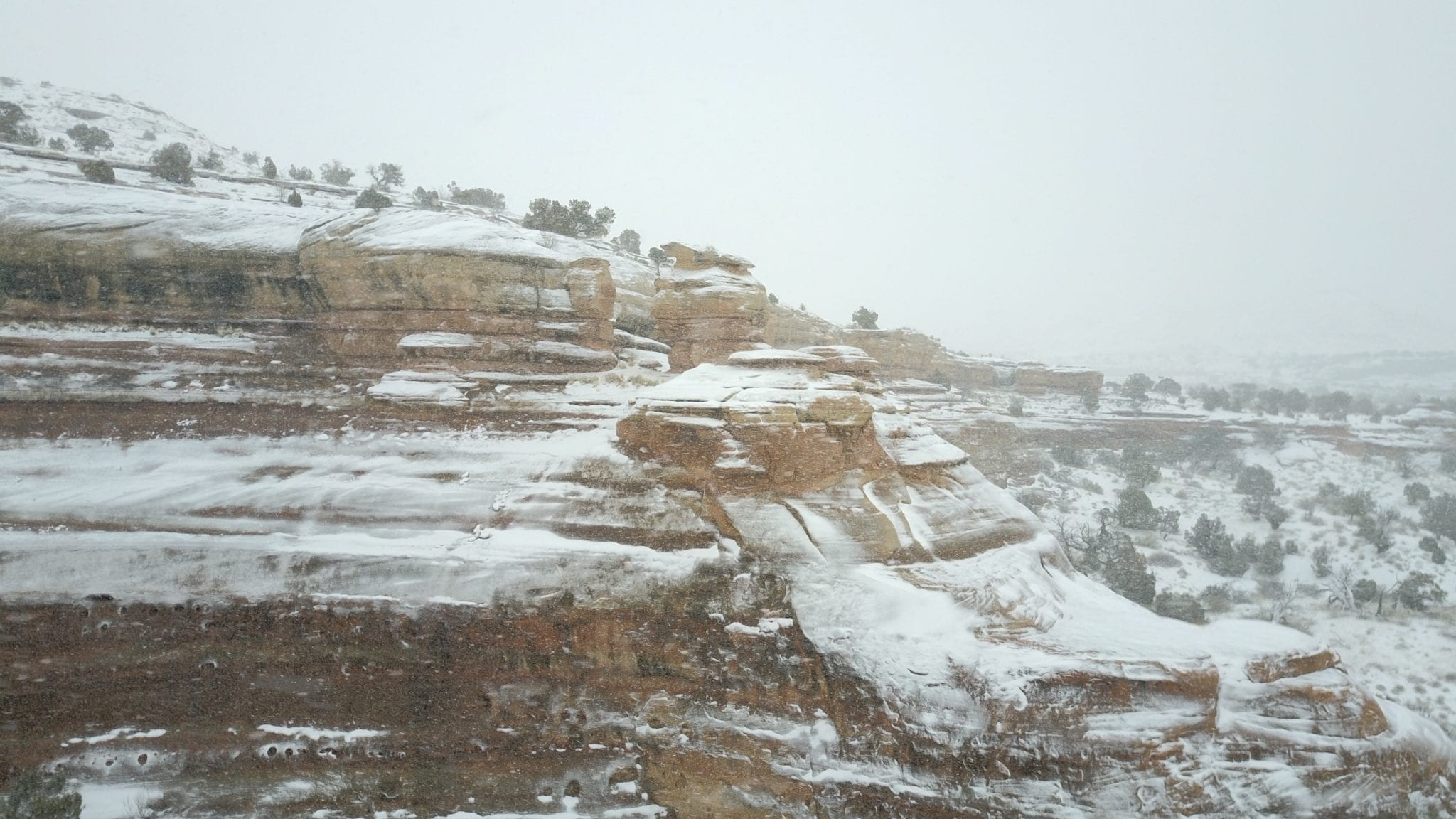 Out of the snowstorm emerges the red rocks of Devil's Canyon.