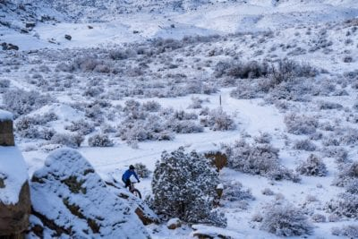 A mountain biker puts down some fresh tracks in the snow at the Lunch Loops trail system in Grand Junction, Colorado