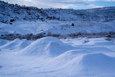 A blanket of snow covers the dirt jumps at the Lunch Loops trail system in Grand Junction, Colorado.