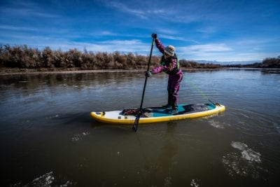 Elizabeth Fortushniak of Grand Junction Stand Up Paddleboarding paddles past some mini ice bergs on the Colorado River