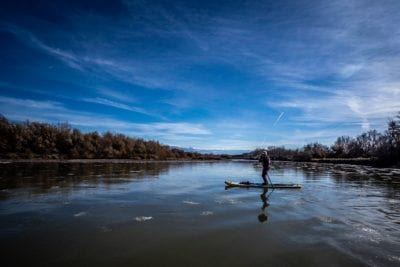 Elizabeth is reflected in the icy water of the Colorado River during a January float.