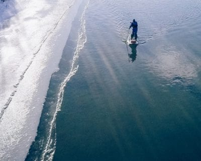 Paddling along the frozen edge of the Colorado River in Grand Junction, Colorado